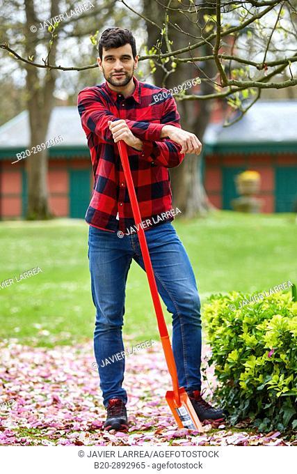 Gardener looking at camera with confidence, Garden, Digging shovel, Aiete Park, Donostia, San Sebastian, Gipuzkoa, Basque Country, Spain, Europe