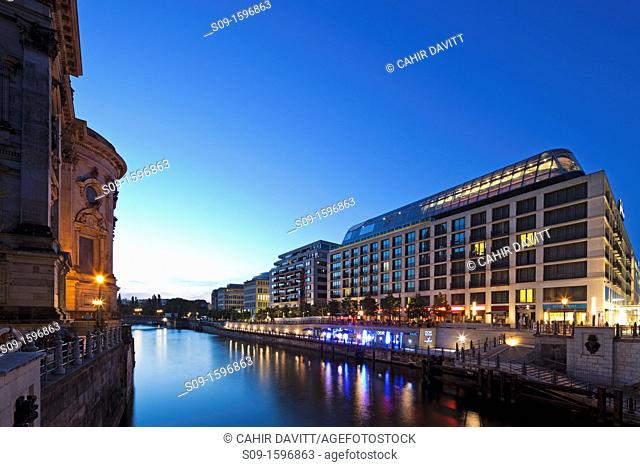 Twilight view of the Radisson Blu Hotel with the back end of the BerlinerDom on the left  Mitte, Berlin, Germany