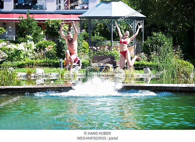 Austria, Salzburg County, Couple jumping into pool