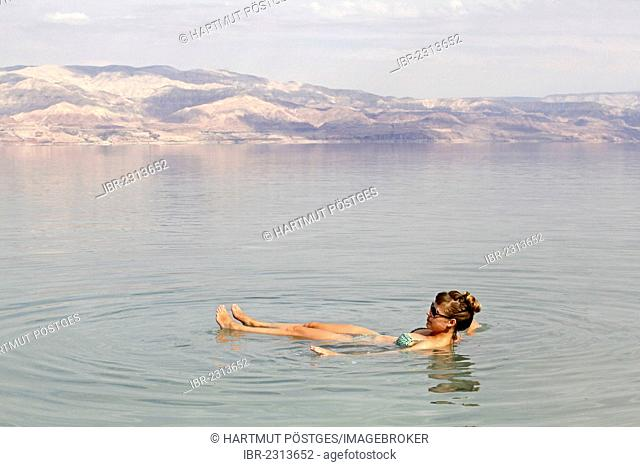 Young woman in the Dead Sea, West Bank, Israel, Middle East