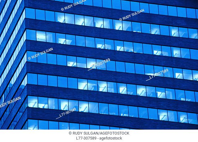 Lit windows in office building. New York City, USA