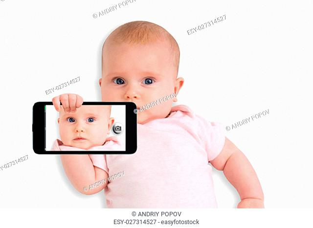 A Cute Baby Taking Selfie With A Mobile Phone Over White Background