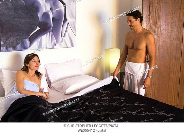 young couple talking in bedroom