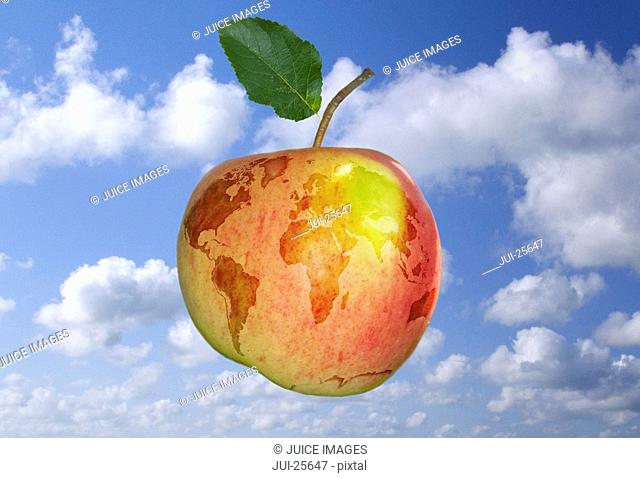 Apple with globe design against blue sky and clouds