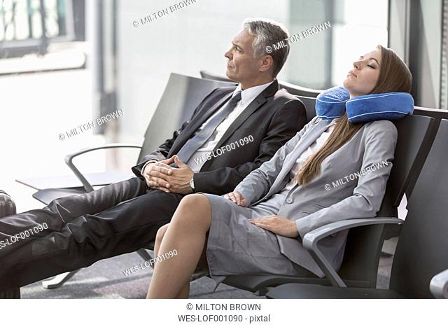 Businessman and businesswoman waiting at the airport