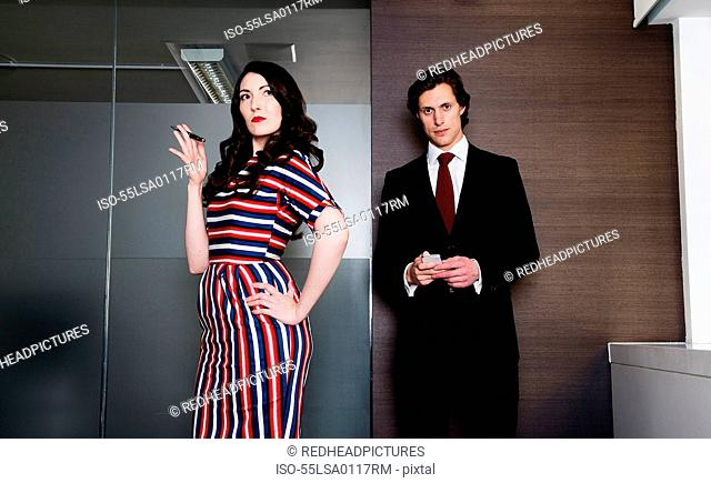 Woman and man executive standing next to each other