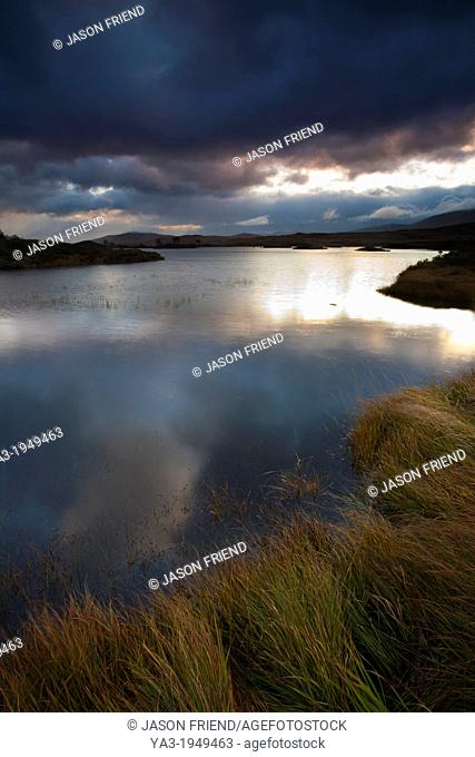Scotland, Scottish Highlands, Rannoch Moor. Early morning sun on Loch Ba located on Rannoch Moor