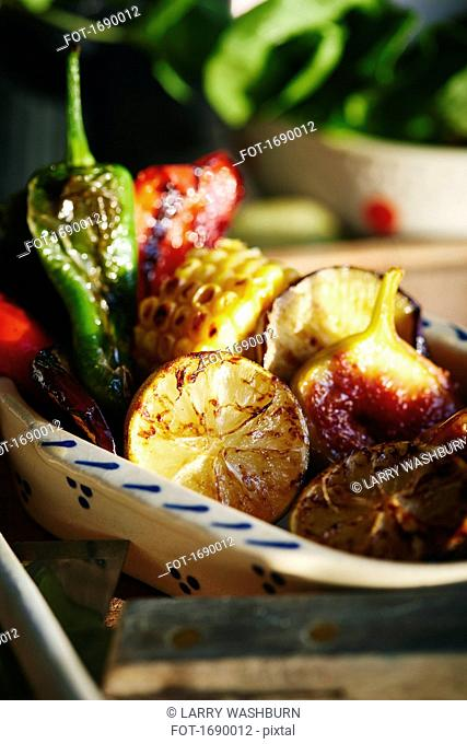 Close-up of roasted fruits and vegetables in plate