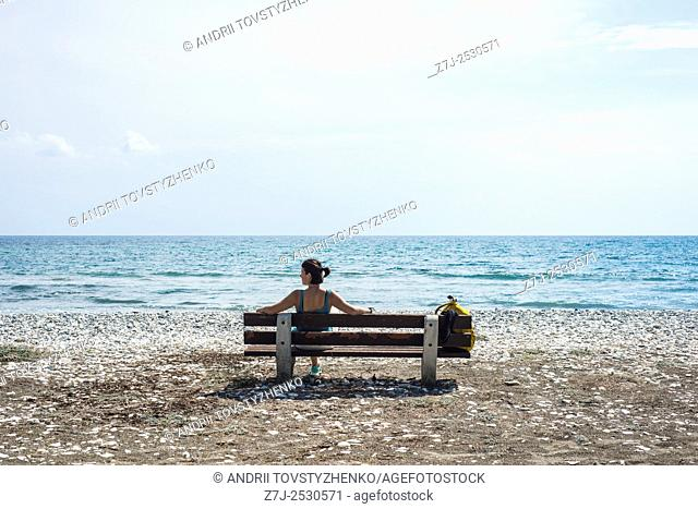 he girl on the bench in the background the Mediterranean sea