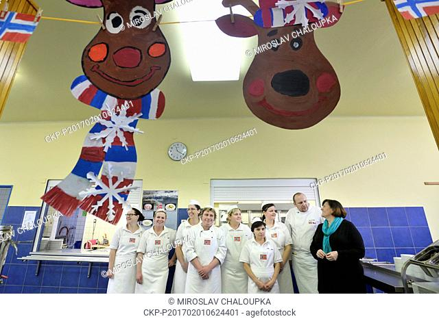 Chef Vaclav Hokr, second from right, pose with his staff in the school canteen in the 15th elementary school in Pilsen, Czech Republic