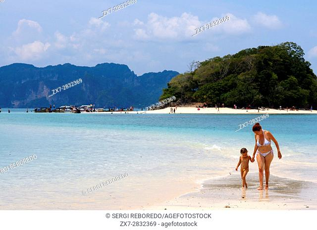 Visitors on the exotic white sand beach Ko Tup island off Ao Nang Thailand. Ko Poda is an island off the west coast of Thailand, in Krabi Province