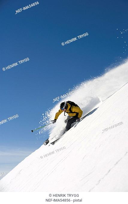 Skier in action, downhill