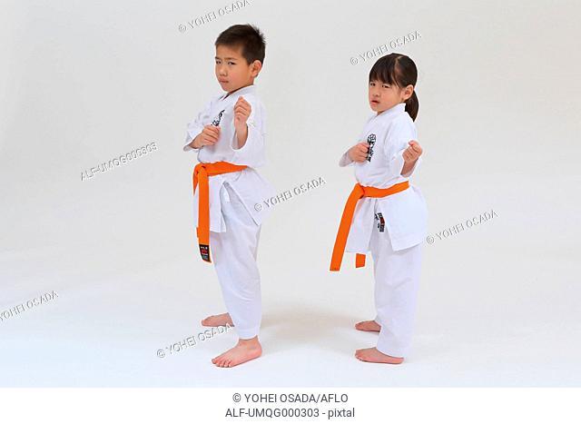 Japanese kids in karate uniform on white background