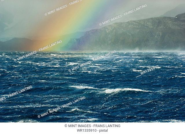 Rainbow over the stormy sea off South Georgia Island in the South Atlantic Ocean