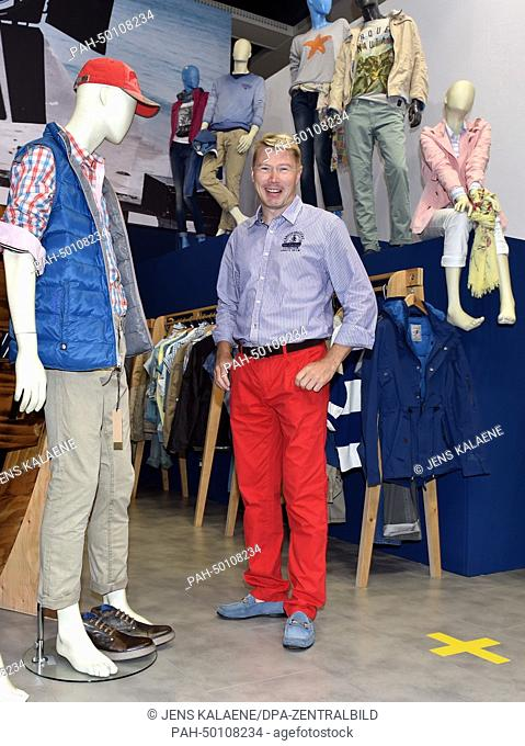 Former Formula One driver Mika Hakkinen poses at the booth of the Arqueonautas label at the fashion fair Panorama during the Mercedes-Benz Fashion Week in...