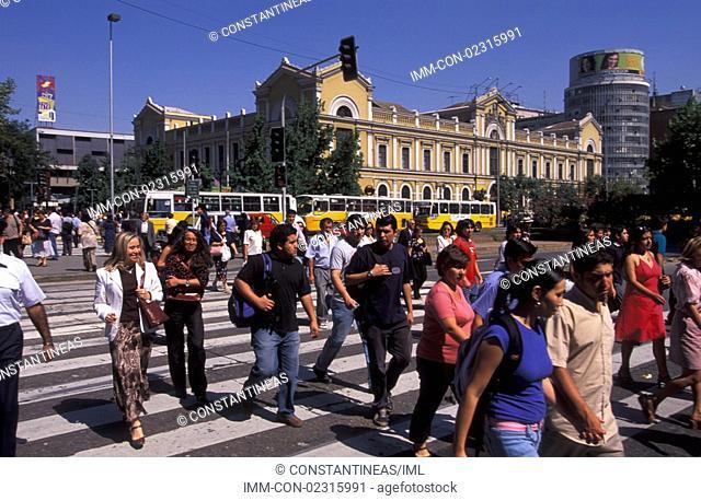 Avenida Libertador Bernardo O'Higgins, people walking on pedestrian crossing  Santiago, Chile, South America