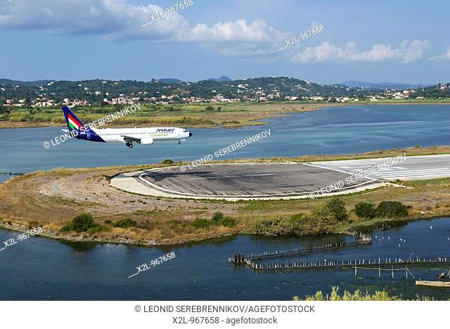 Airplane lands in the Kerkyra airport  Corfu island, Greece