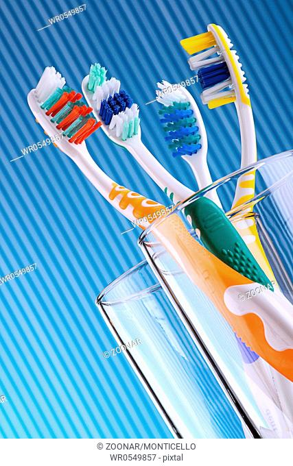 Composition with four toothbrushes