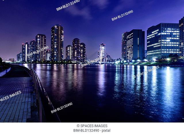 Silhouette of Tokyo skyline lit up at night, Tokyo, Japan