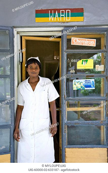 Kano, Nigeria: June 10, 2008. A health official at the Bukavu Barracks public clinic in Kano Nigeria stands next to a Waterguard advertisement