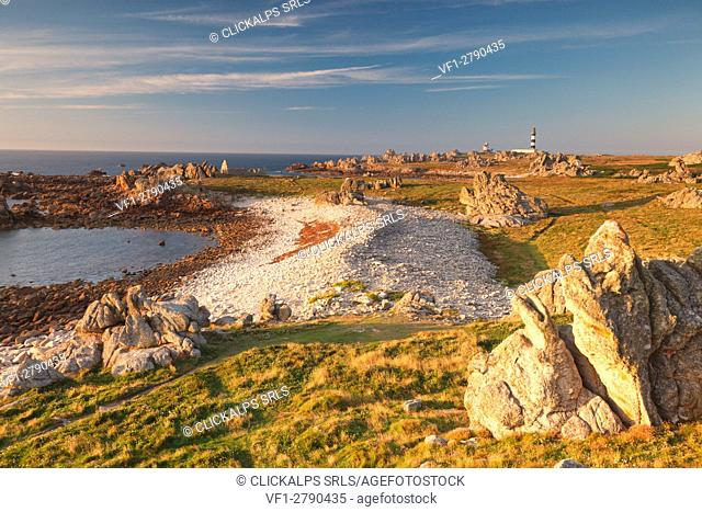 Ouessant island, Brittany, France. The point most westerly of the island at sunset. In background, you can see the Creach lighthouse