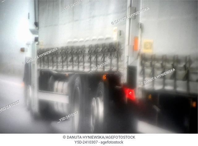 truck on a highway in heavy rain, Germany