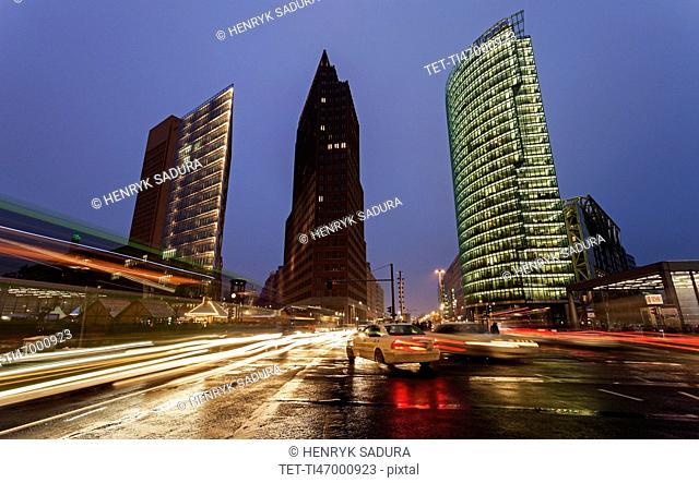 Illuminated skyscrapers and street traffic