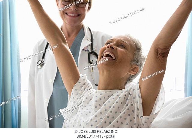 Patient cheering in hospital room