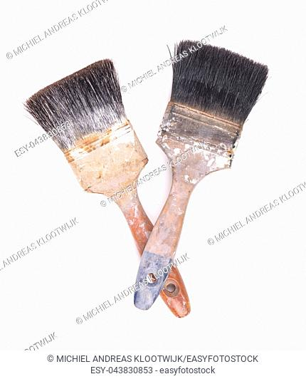 Old paintbrushes isolated on a white background