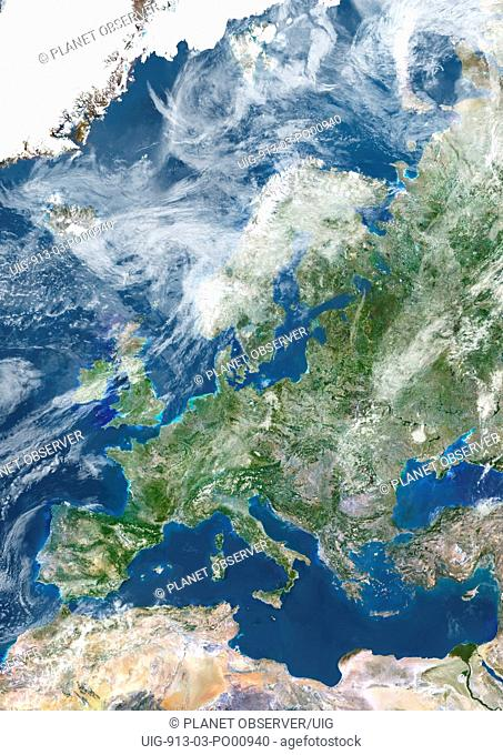 Europe With Cloud Coverage, True Colour Satellite Image. True colour satellite image of Europe with cloud coverage. This image in Lambert Conformal Conic...