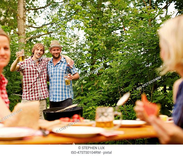 Friends drinking beer outdoors