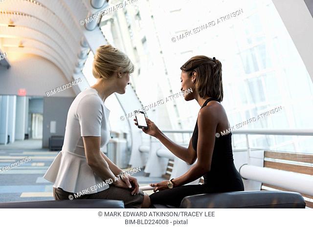 Businesswomen using cell phone