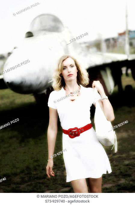 Bussiness woman in front a military russian plane