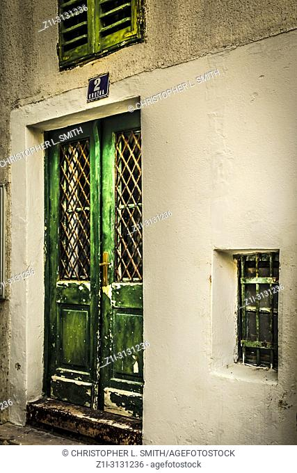 Green doors leading into a Croatian home along narrow streets in the small fishing village of Baska on the island of Krk in the Adriatic