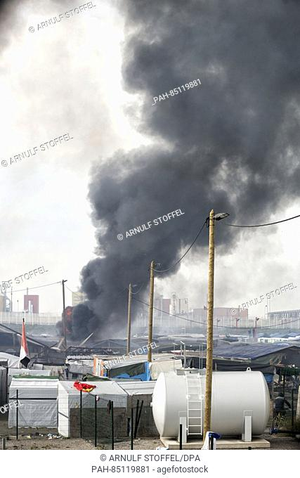 Chaotic scenes in the Calais Jungle after dozens of fires were set leading to a series of explosions shortly before a police operation to clear the refugee camp...