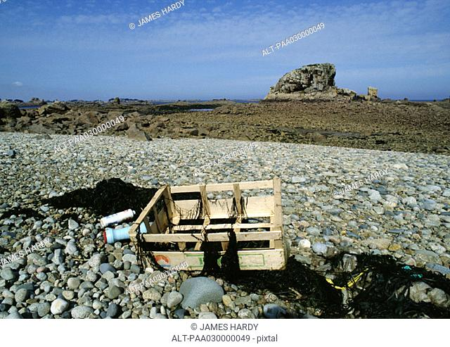 Crate and plastics on rocky terrain