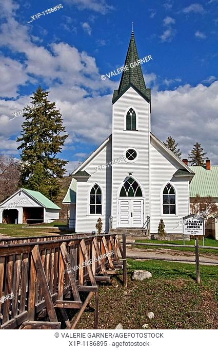 This white classic turn of the century church was built in 1917 and is located in Havillah Washington in Okanogan County It's shot during the day with bright...