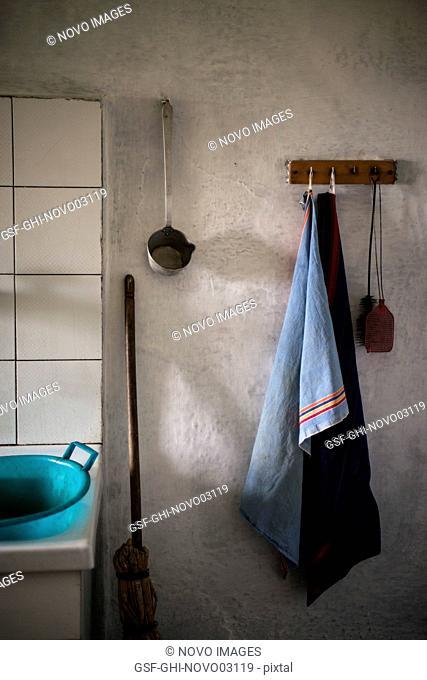 Light Blue dishcloth Hanging next to Old Kitchen Sink