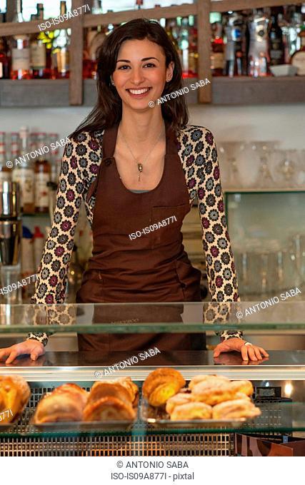 Female shopkeeper at counter