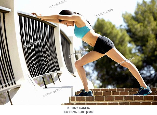 Jogger stretching on stairs