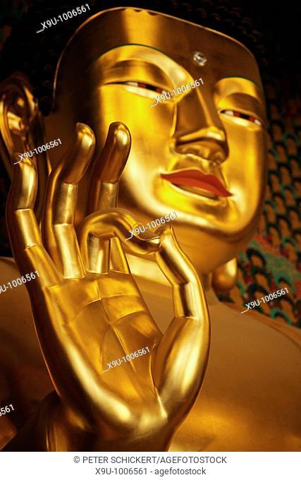 golden buddha inside the buddhist temple Jogyesa in South Koreas Capital Seoul, Asia
