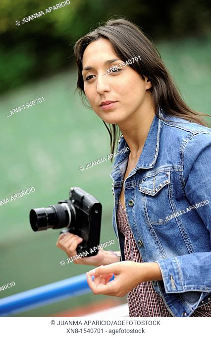 Young woman with reflex camera