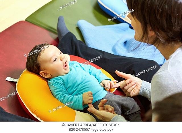 Mother playing with baby boy at breastfeeding education program