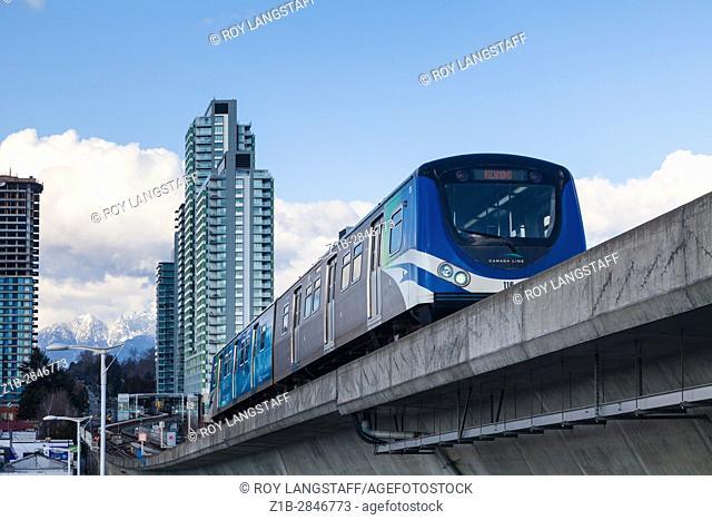 Canada Line driverless train on a concrete bridge