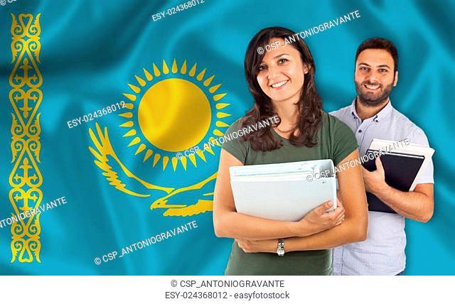Couple of students overKazakh flag
