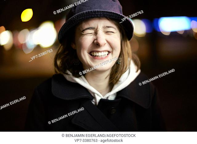 Portrait of a happy young woman, nightlife, in Berlin, Germany
