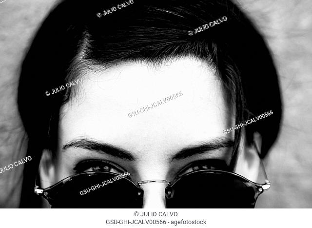 Portrait of Young Adult Woman Looking over her Sunglasses
