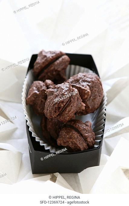 Gluten-free biscuits filled with chocolate, in black box