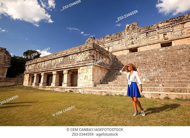 Woman posing in Uxmal Ruins near the Quadrangle Of The Nuns, Yucatan Province, Mexico, Central America