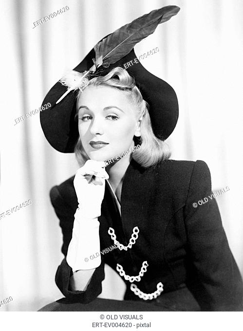 Portrait of woman wearing hat with feather All persons depicted are not longer living and no estate exists Supplier warranties that there will be no model...